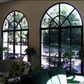 Baies vitrées cintrées